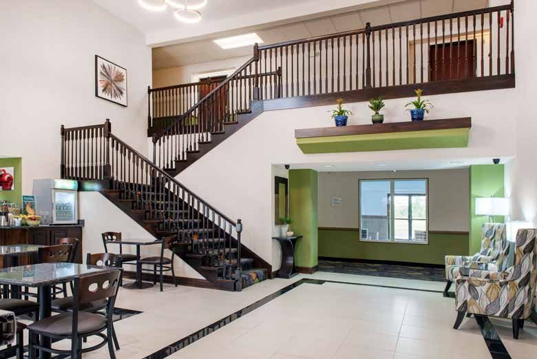 https://qualityinnanderson.com/wp-content/uploads/2017/08/staircase-lobby-quality-inn-anderson-indiana.jpg